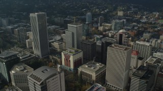 AX153_081 - 6K stock footage aerial video orbiting Wells Fargo Center and skyscrapers in Downtown Portland, Oregon