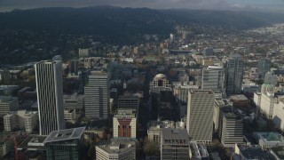 AX153_085 - 6K stock footage aerial video flying over skyscrapers to approach high school sports field in Downtown Portland, Oregon