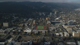 AX153_086 - 6K stock footage aerial video flying over Lincoln High School sports fields to approach apartment buildings in Goose Hollow, Portland, Oregon