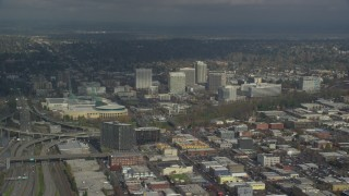 AX153_091 - 6K stock footage aerial video of Oregon Convention Center and office buildings in Lloyd District of Portland, Oregon