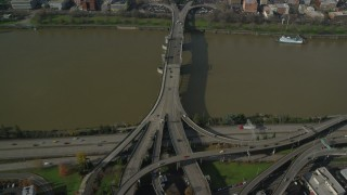 AX153_093 - 6K stock footage aerial video tilting from Morrison Bridge to reveal and approach Downtown Portland, Oregon