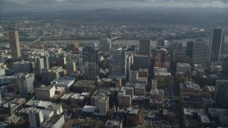 AX153_098 - 6K stock footage aerial video flying by Park Avenue West and Fox Tower to approach Morrison Bridge in Downtown Portland, Oregon
