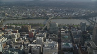 AX153_099 - 6K stock footage aerial video approaching and flying over the Morrison Bridge in Downtown Portland, Oregon