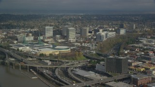 AX153_100 - 6K stock footage aerial video of Oregon Convention Center and office buildings in Lloyd District, Portland, Oregon
