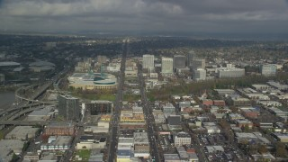 AX153_101 - 6K stock footage aerial video passing the Oregon Convention Center and office buildings in Lloyd District, Portland, Oregon