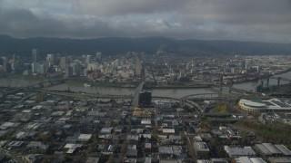 AX153_104 - 6K stock footage aerial video approaching Burnside Bridge toward Downtown Portland, Oregon