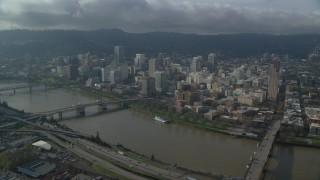 AX153_105 - 6K stock footage aerial video crossing the Willamette River toward Downtown Portland, Oregon