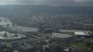AX153_113 - 6K stock footage aerial video of skyscrapers in Downtown Portland seen from Moda Center in Oregon