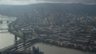AX153_115 - 6K stock footage aerial video approaching US Bancorp Tower and skyscrapers in Downtown Portland, Oregon