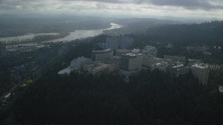 AX153_119 - 6K stock footage aerial video approaching and fly over the Oregon Health and Science University in Portland, Oregon