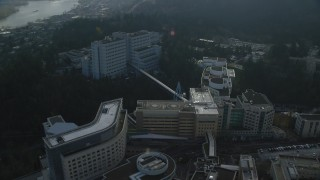 AX153_120 - 6K stock footage aerial video flying over the Oregon Health and Science University complex in Portland, Oregon