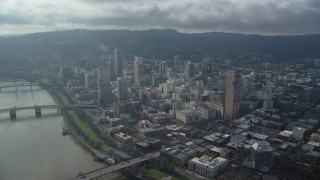 AX153_123 - 6K stock footage aerial video approaching skyscrapers and high-rises in Downtown Portland, Oregon