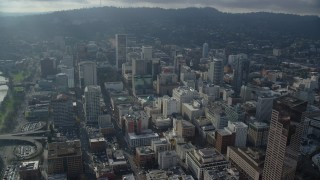 AX153_124 - 6K stock footage aerial video approaching Wells Fargo Center and skyscrapers in Downtown Portland, Oregon