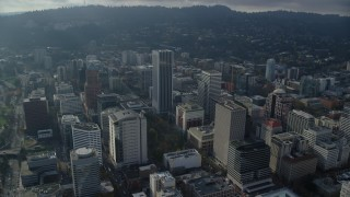 AX153_125 - 6K stock footage aerial video orbiting KOIN Center and Wells Fargo Center in Downtown Portland, Oregon