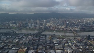 AX153_128 - 6K stock footage aerial video from across the Willamette River of bridges and Downtown Portland, Oregon
