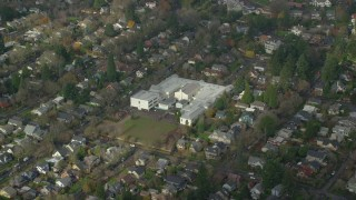 AX153_130 - 6K stock footage aerial video of Alameda Elementary School in Northeast Portland, Oregon