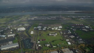 AX153_133 - 6K stock footage aerial video approaching Portland International Airport and the Columbia River in Oregon