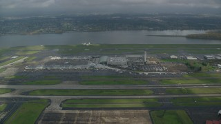 AX153_134 - 6K stock footage aerial video approaching Portland International Airport in Oregon and tilt down to terminals
