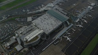 AX153_136 - 6K stock footage aerial video flying away from Portland International Airport in Oregon