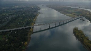 AX153_138 - 6K stock footage aerial video approaching I-205 Bridge spanning Columbia River in Vancouver, Washington