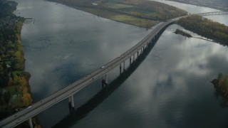 AX153_139 - 6K stock footage aerial video of I-205 Bridge over the Columbia River in Vancouver, Washington