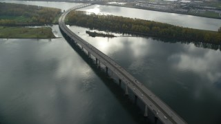 AX153_140 - 6K stock footage aerial video of the I-205 Bridge spanning the Columbia River in Vancouver, Washington