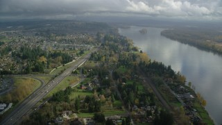 AX153_143 - 6K stock footage aerial video flying over suburban homes between Highway 14 and Columbia River, Vancouver, Washington