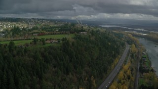 AX153_147 - 6K stock footage aerial video flying by mansions to approach a hilltop suburban neighborhood in Camas, Washington