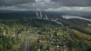 AX153_149 - 6K stock footage aerial video flying over Highway 14 to approach paper mill in Camas, Washington
