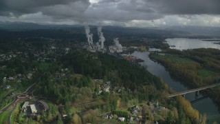 AX153_150 - 6K stock footage aerial video approaching Georgia Pacific Paper Mill in Camas, Washington