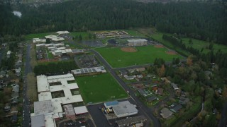AX153_156 - 6K stock footage aerial video orbiting school campus and baseball fields in Camas, Washington