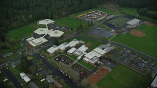 AX153_157 - 6K stock footage aerial video orbiting Helen Baller Elementary School in Camas, Washington