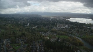 AX153_159 - 6K stock footage aerial video flying over Camas to approach tract homes and the Washougal River in Washougal, Washington