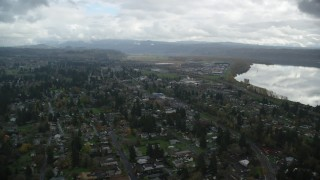 AX153_161 - 6K stock footage aerial video flying over small town neighborhoods in Washougal, Washington