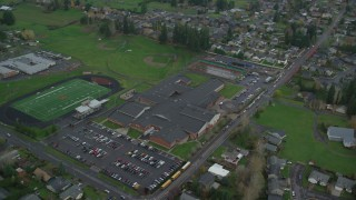 AX153_167 - 6K stock footage aerial video orbiting Washougal High School and the football field in Washougal, Washington