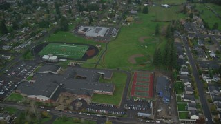 AX153_168 - 6K stock footage aerial video orbiting an elementary school and high school in Washougal, Washington