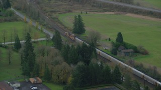 AX153_172 - 6K stock footage aerial video tracking a train in Washougal, Washington