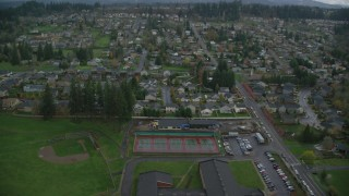 AX153_174 - 6K stock footage aerial video approaching and flying over suburban homes Washougal, WA