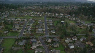 AX153_175 - 6K stock footage aerial video flying over suburban tract homes in Washougal, Washington