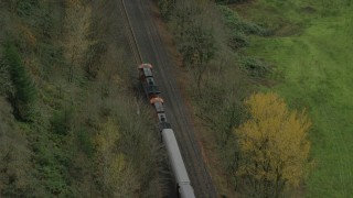 AX153_181 - 6K stock footage aerial video of a bird's eye tracking of a train traveling Columbia River Gorge, Oregon