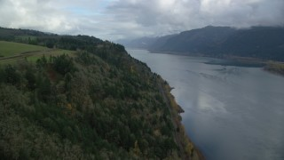 AX153_184 - 6K stock footage aerial video approaching the Columbia River Gorge in Oregon