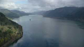 AX153_186 - 6K stock footage aerial video flying over the river in Columbia River Gorge, Oregon