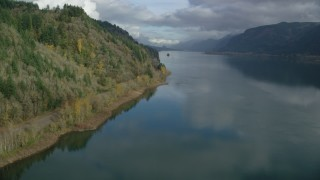 AX154_002 - 6K stock footage aerial video flying low over the river in Columbia River Gorge, Oregon