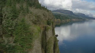 AX154_006 - 6K stock footage aerial video revealing three waterfalls in Columbia River Gorge, Washington