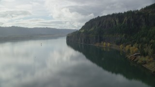 AX154_008 - 6K stock footage aerial video approaching an isolated home and railroad tunnel in Columbia River Gorge, Washington