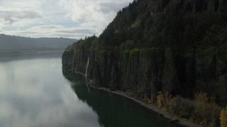 AX154_010 - 6K stock footage aerial video ascending cliffs, Cape Horn Falls in Columbia River Gorge, Washington