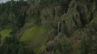 AX154_011 - 6K stock footage aerial video tracking Cape Horn Falls through steep cliffs in Columbia River Gorge, Washington
