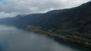 AX154_017 - 6K stock footage aerial video approaching a waterfall on a Columbia River Gorge cliff in Multnomah County, Oregon