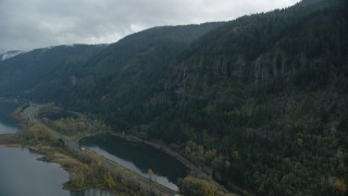 AX154_018 - 6K stock footage aerial video approaching a waterfall on a Columbia River Gorge cliff face in Multnomah County, Oregon