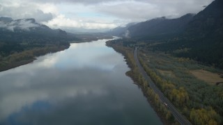 AX154_023 - 6K stock footage aerial video following the river and I-84 through Columbia River Gorge, Multnomah County, Oregon